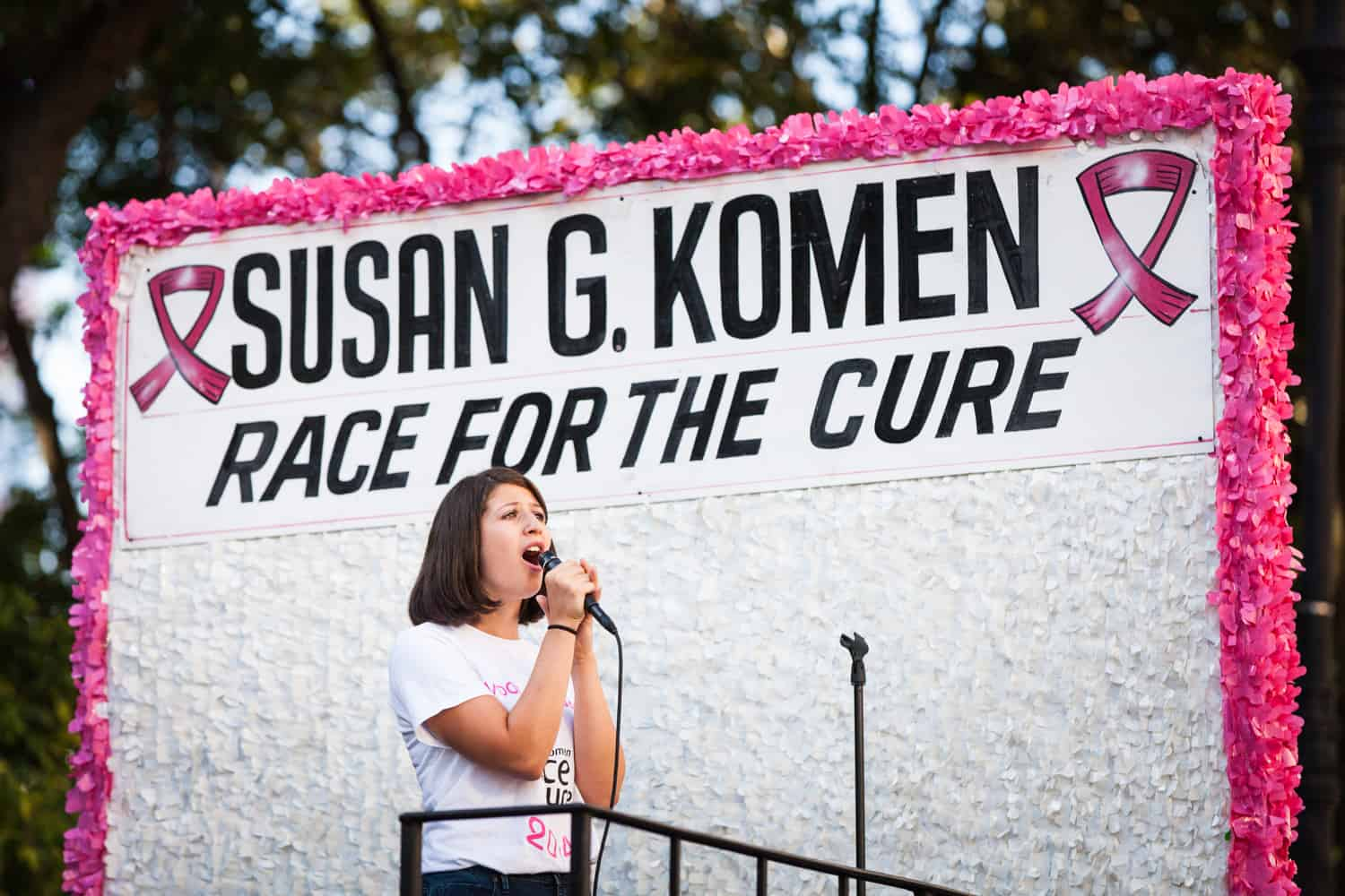 NYC Race for the Cure photos of woman singing on parade float