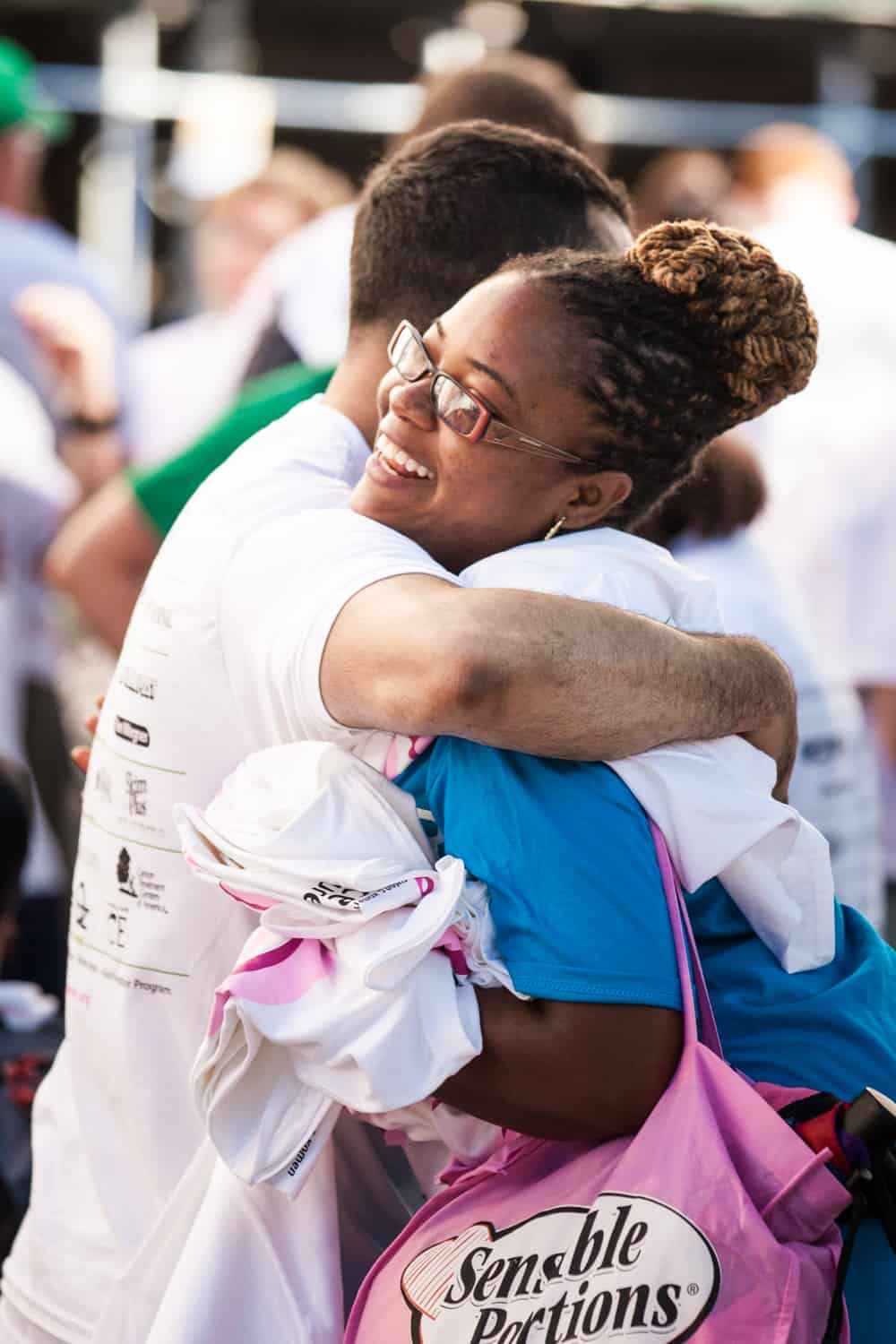NYC Race for the Cure photos of African American woman hugging man