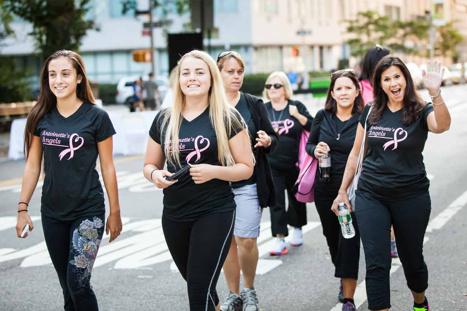 NYC Race for the Cure photos of group of supporters wearing black outfits