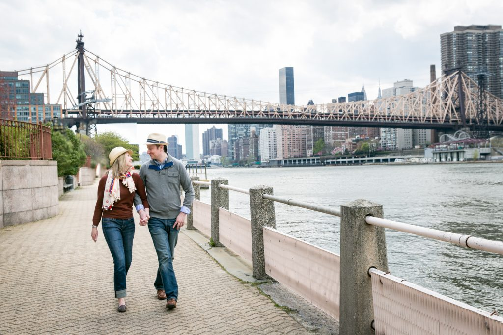 Couple walking hand-in-hand during a Roosevelt Island engagement portrait session