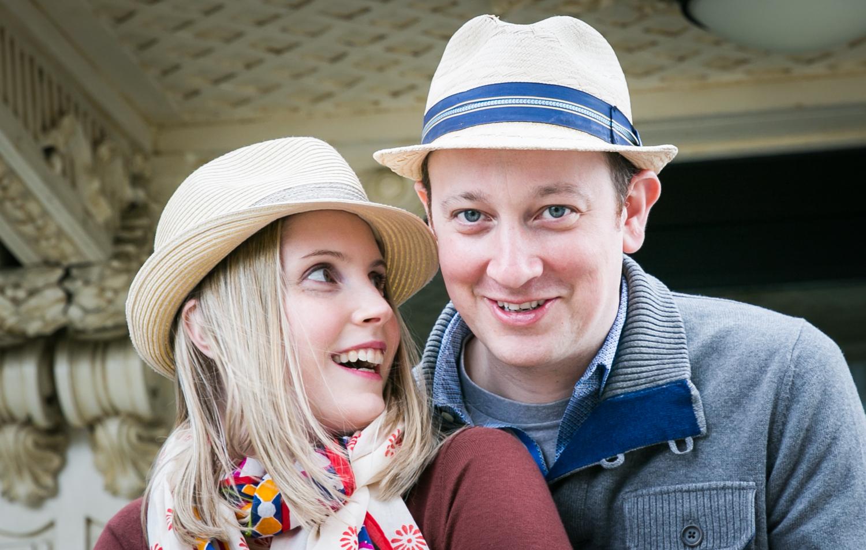Couple wearing hats under Roosevelt Island tram