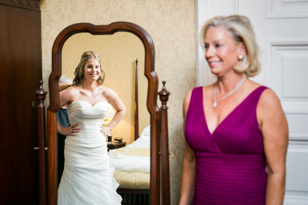 Mother seeing bride in dress for the first time before a University Club wedding