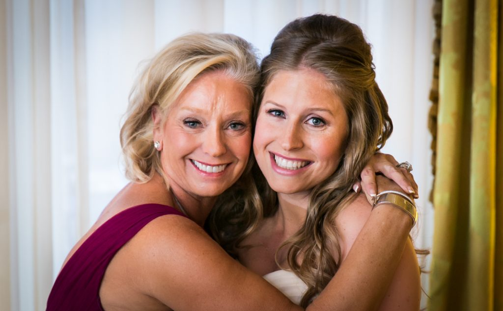 Mother and bride hugging before a University Club wedding