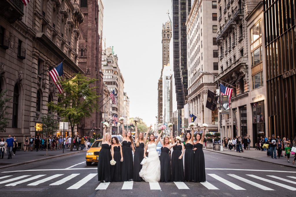 Bride and bridesmaids in the crosswalk of Fifth Avenue before a University Club wedding