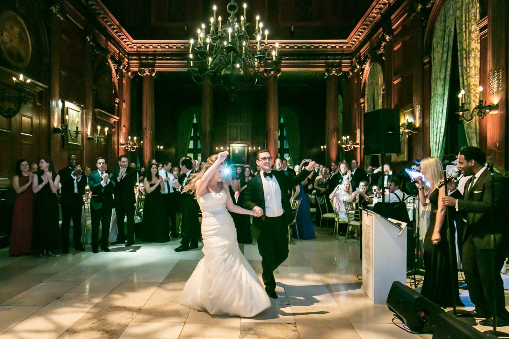 Bride and groom entering a University Club wedding reception