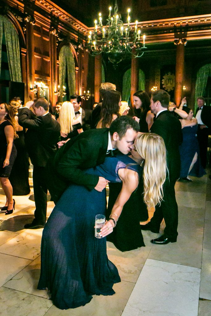Couple kissing deeply on the dance floor at a University Club wedding