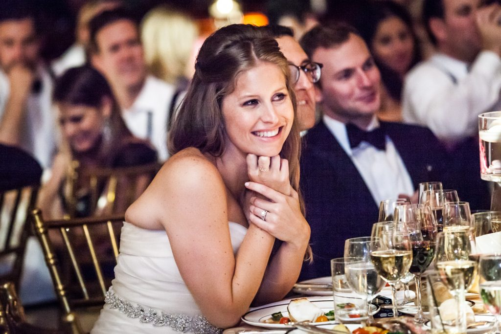 Bride listening to speeches at a University Club wedding