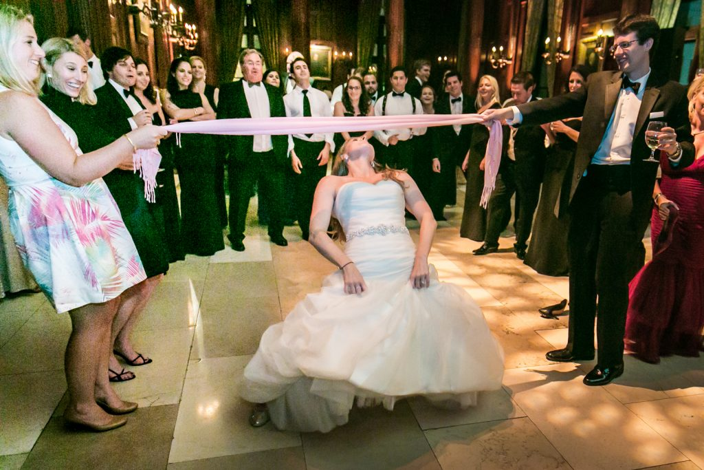 Bride dancing the limbo at a University Club wedding