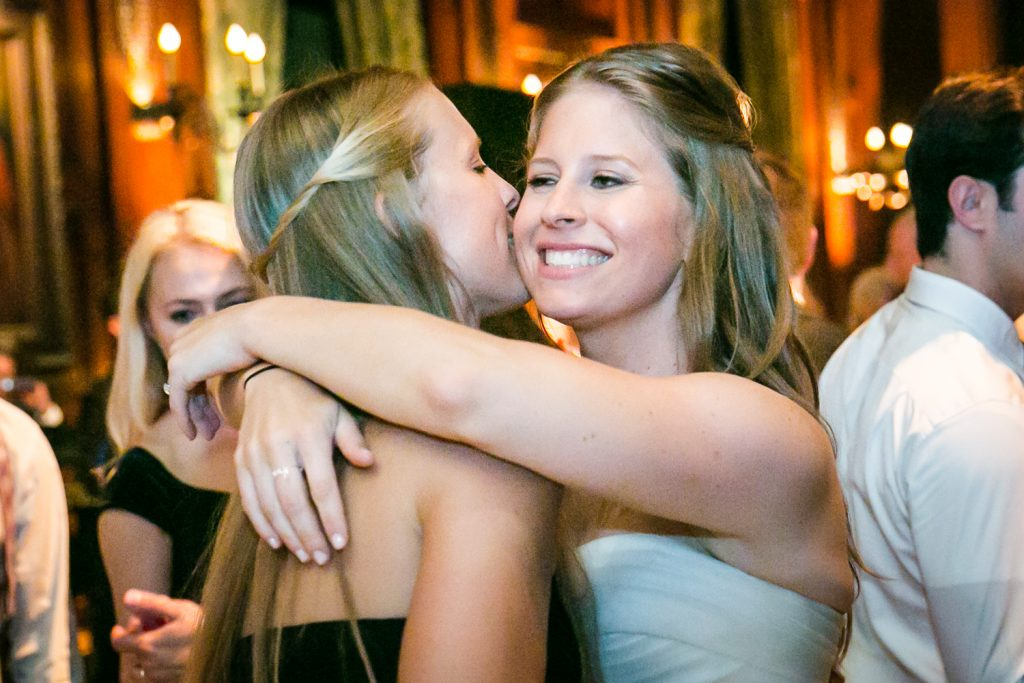 Bride hugging sister during a University Club wedding