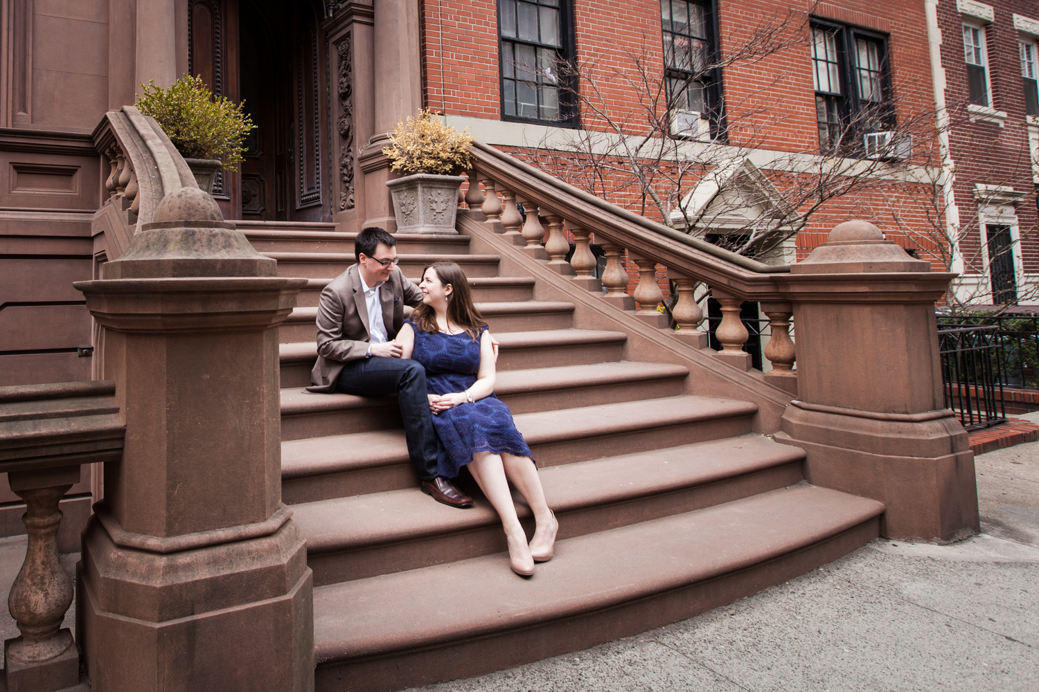 Brooklyn Promenade engagement photos of couple sitting on stairs of Brooklyn brownstone