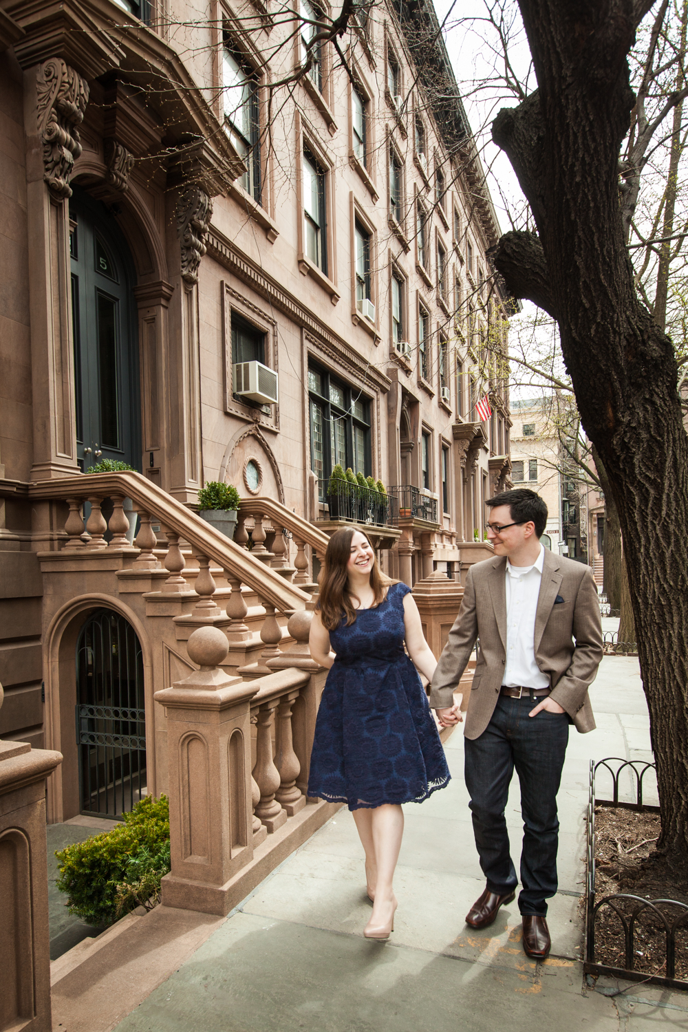 Brooklyn Promenade engagement photos of couple walking past brownstones