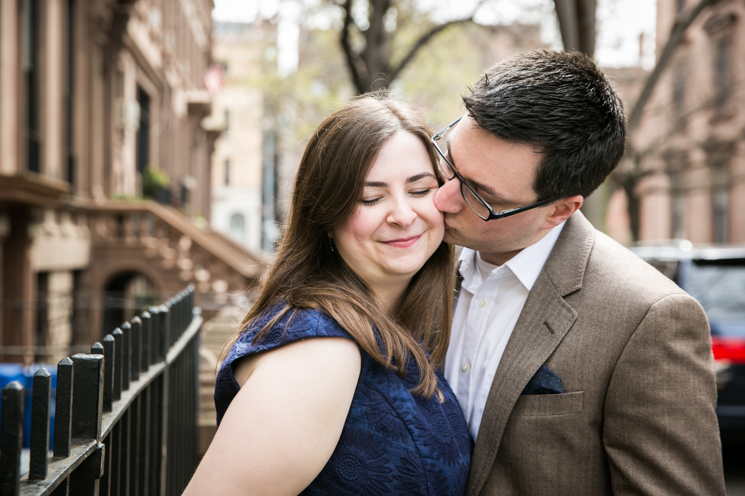 Brooklyn Promenade engagement photos of man kissing woman on the cheek