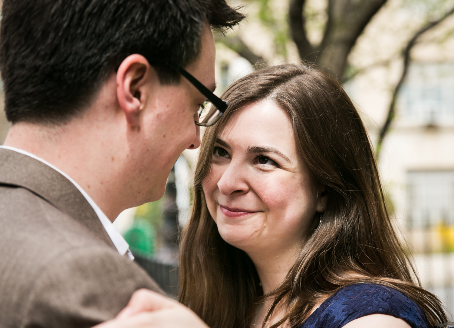Brooklyn Promenade engagement photos of woman looking at man wearing glasses