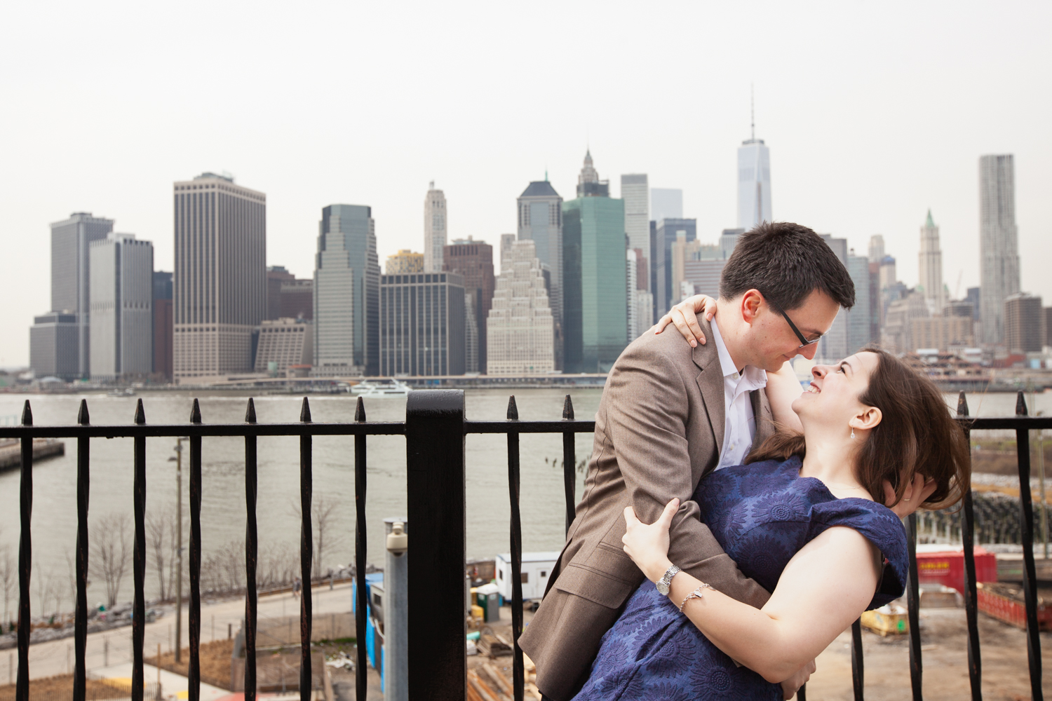 Couple dancing on Brooklyn Promenade with NYC skyline in background