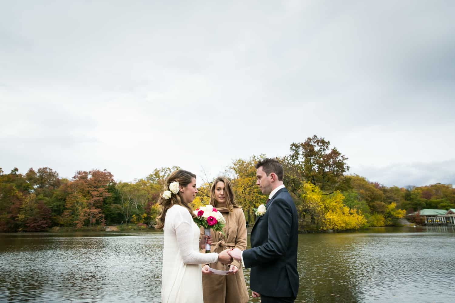 Bride and groom exchanging vows at a Bethesda Fountain wedding in Central Park