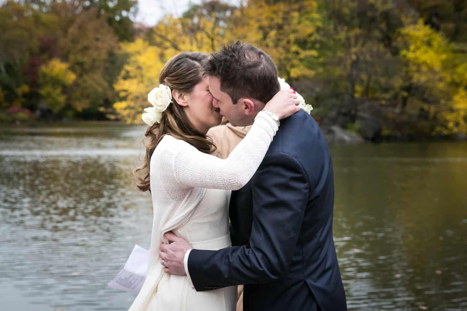 Bride and groom kissing at a Bethesda Fountain wedding in Central Park