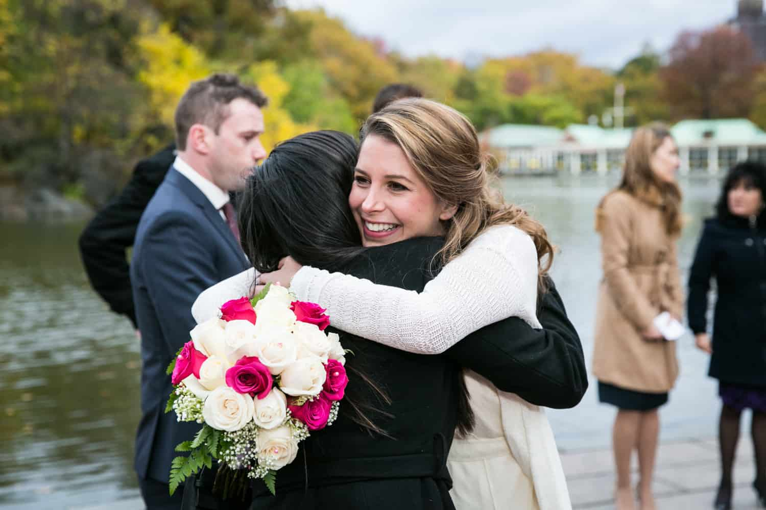 Bride hugging guest at a Bethesda Fountain wedding in Central Park