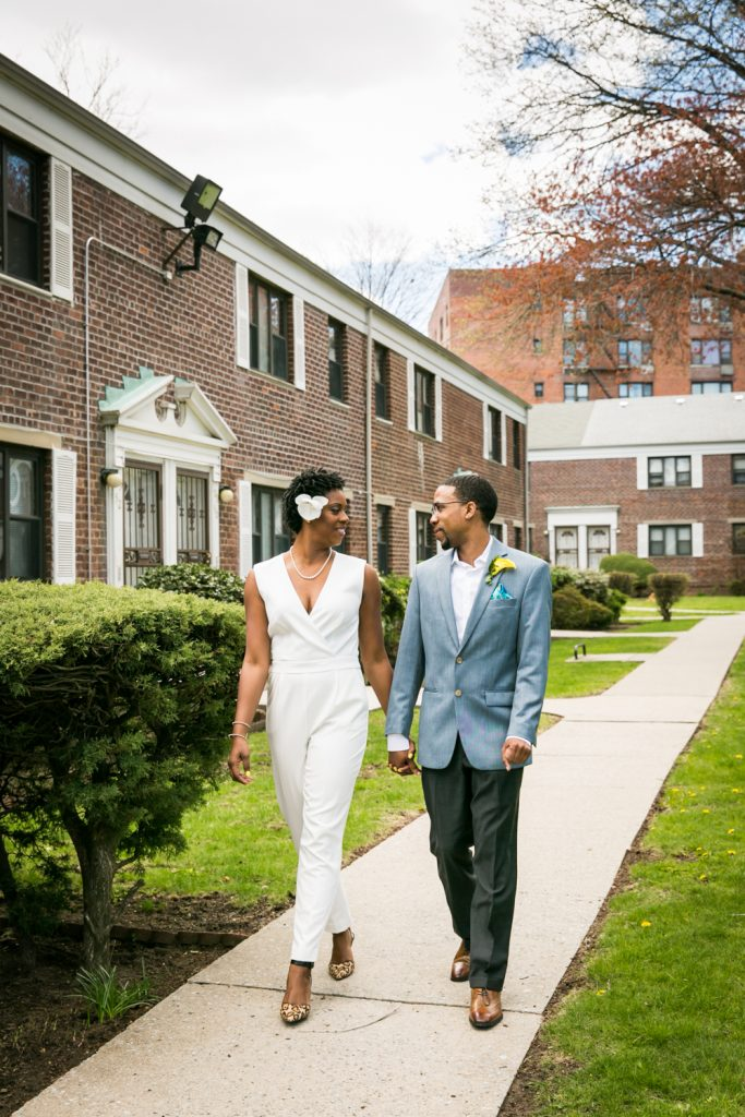 Bride and groom walking on sidewalk at a Flushing Meadows Corona Park wedding