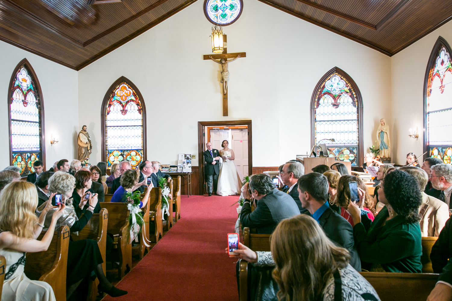 Wide shot of bride and father about to walk down aisle at St. James Church