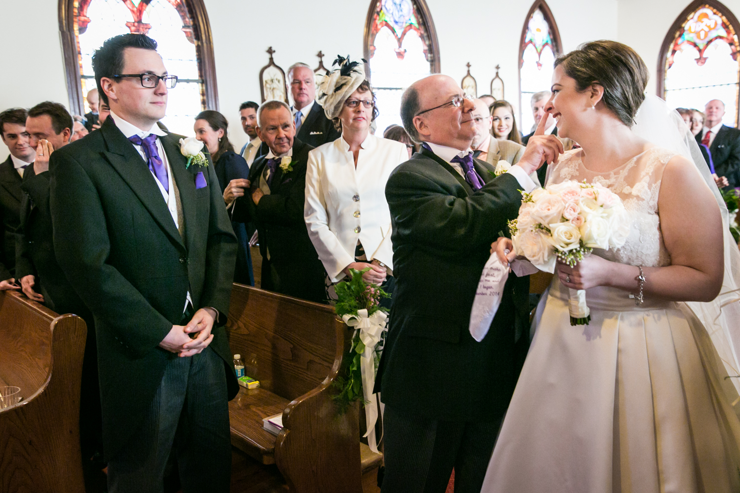 Father giving bride away during ceremony at St. James Church