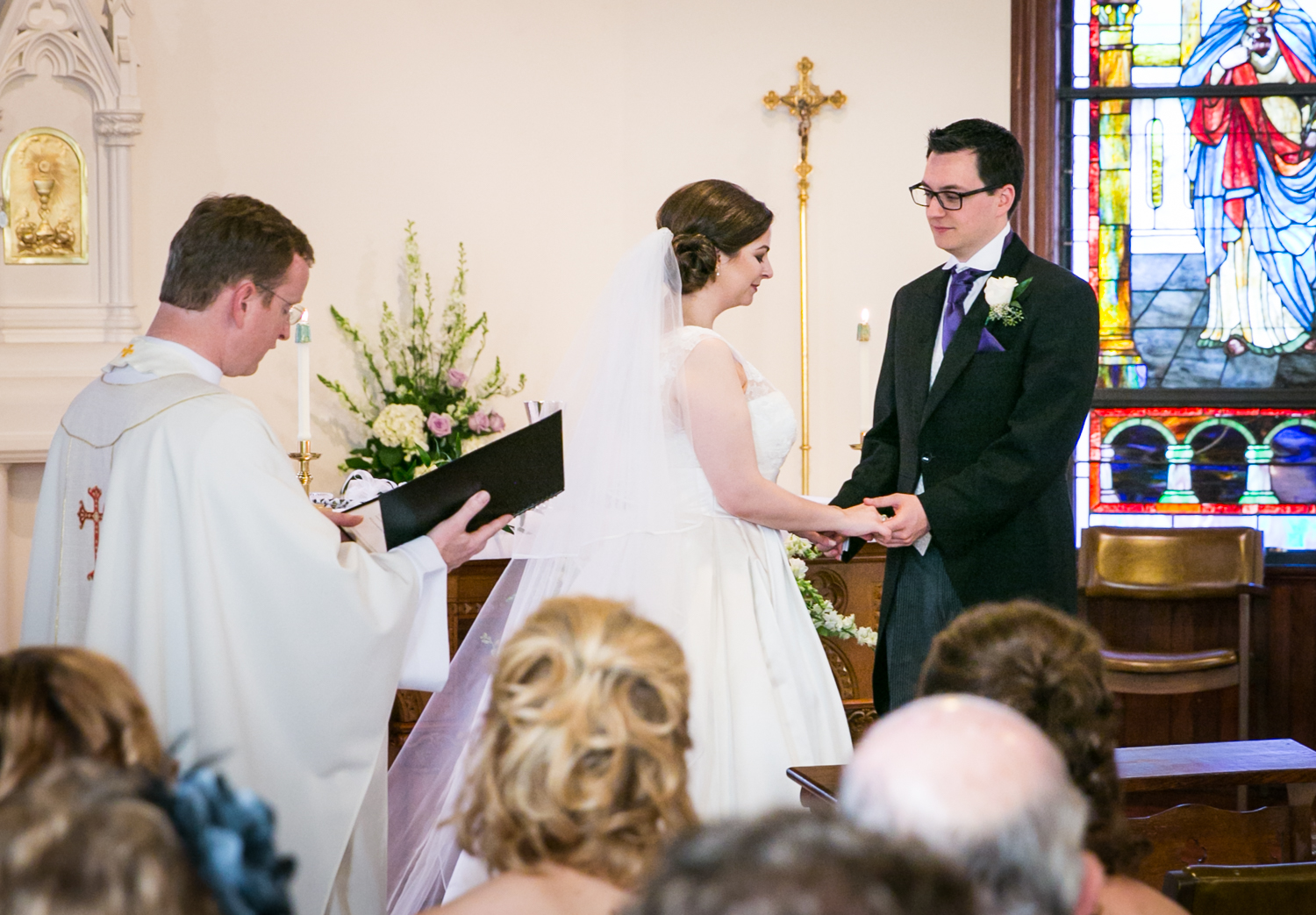Bride and groom exchanging vows at St. James Church