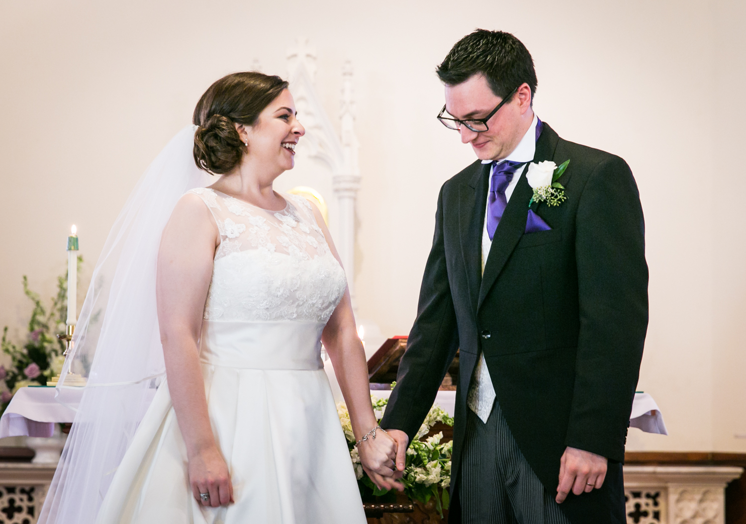 Bride and groom standing at altar in St. James Church