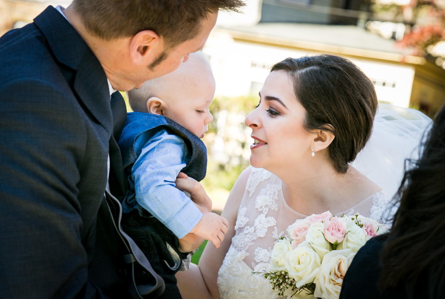 Bride playing with baby