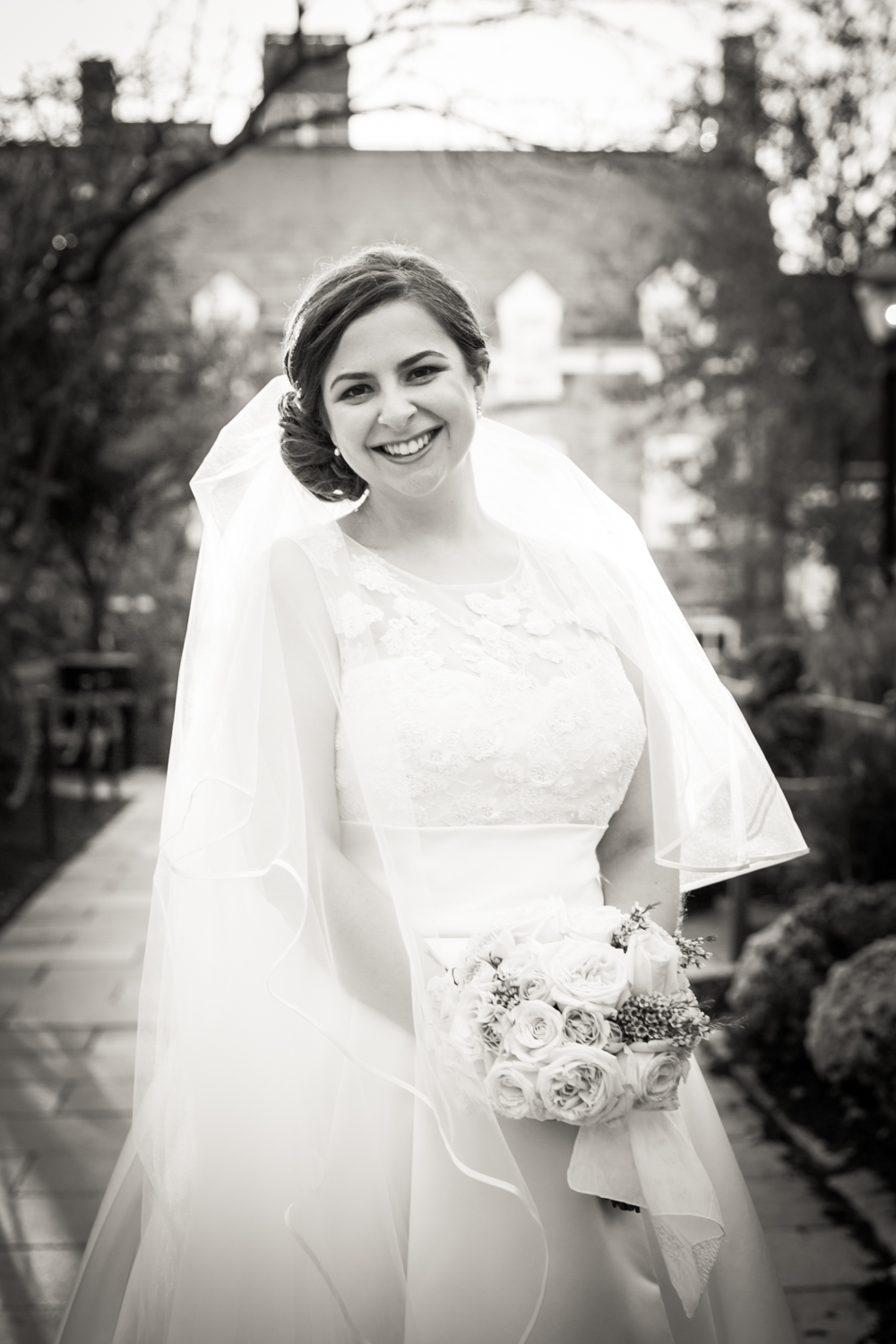 Black and white portrait of bride outdoors