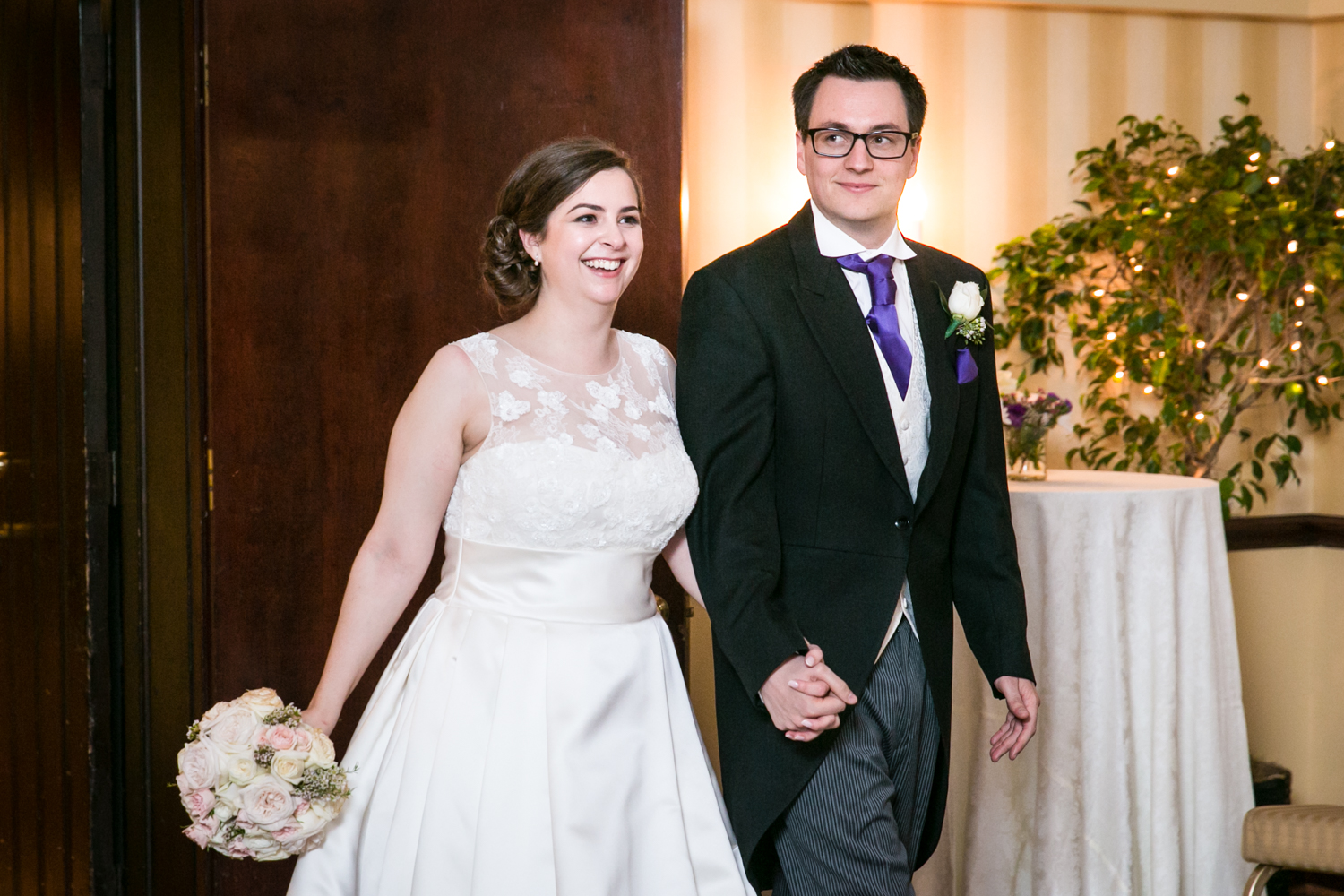 Bride and groom entering reception at a Nassau Inn wedding