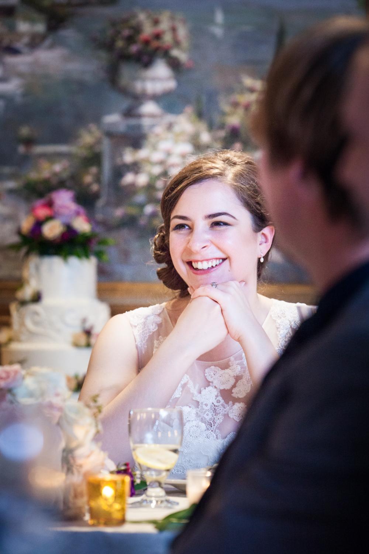 Bride listening to speeches at a Nassau Inn wedding