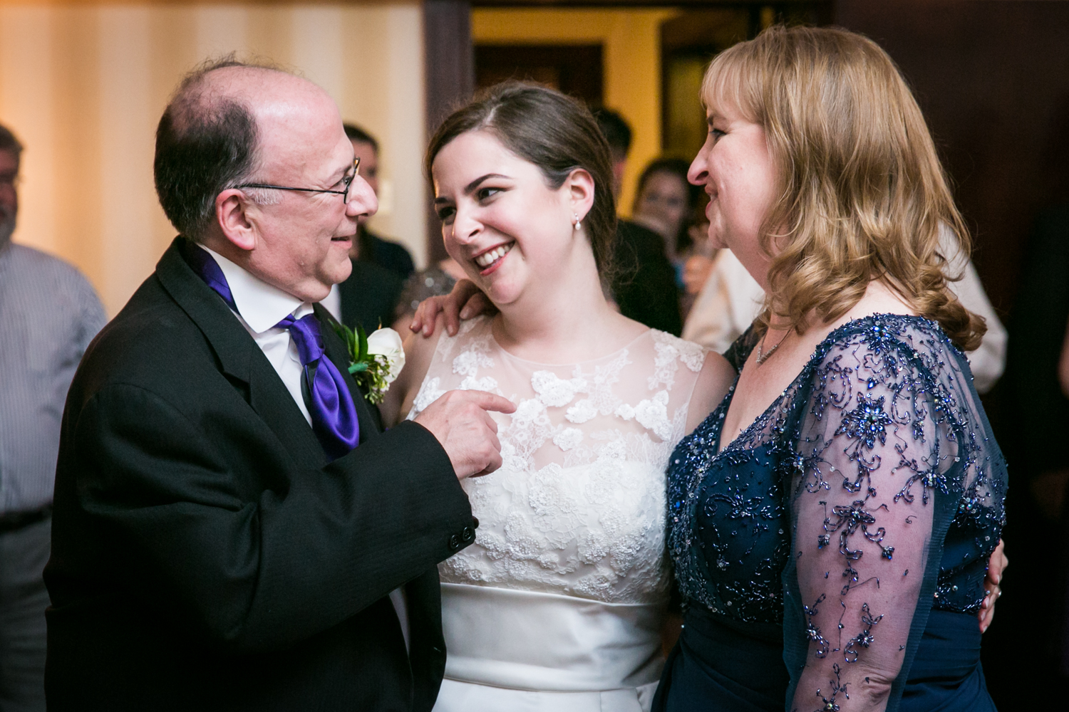 Bride laughing with both parents at a Nassau Inn wedding