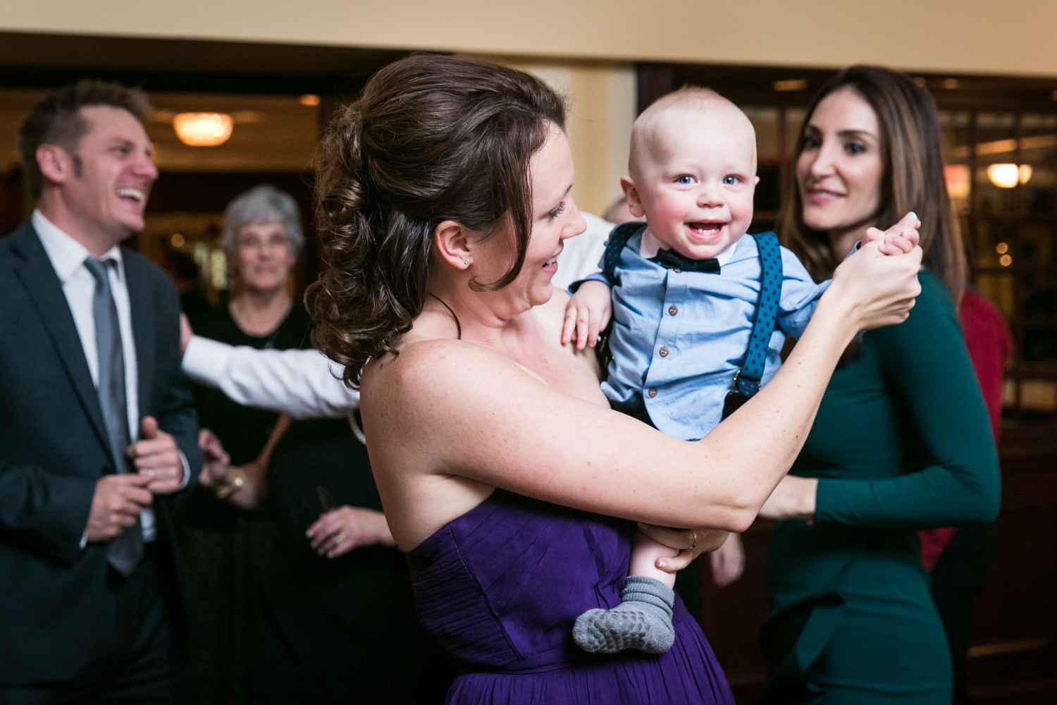 Woman dancing with baby at a Nassau Inn wedding