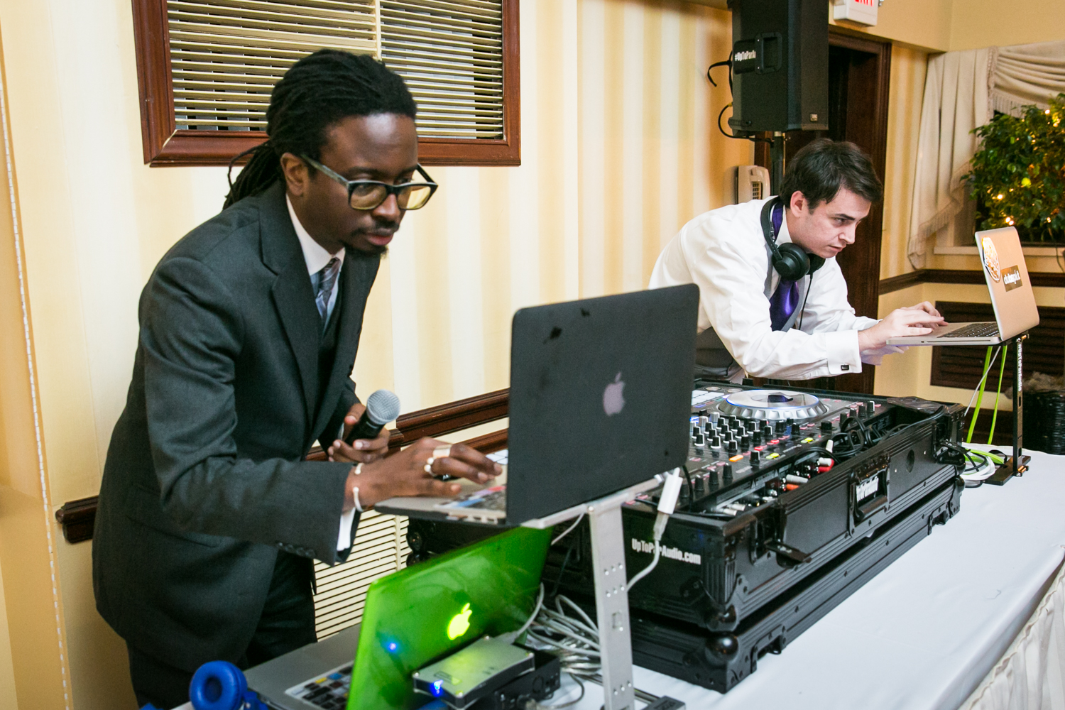 DJ and bride's brother playing music