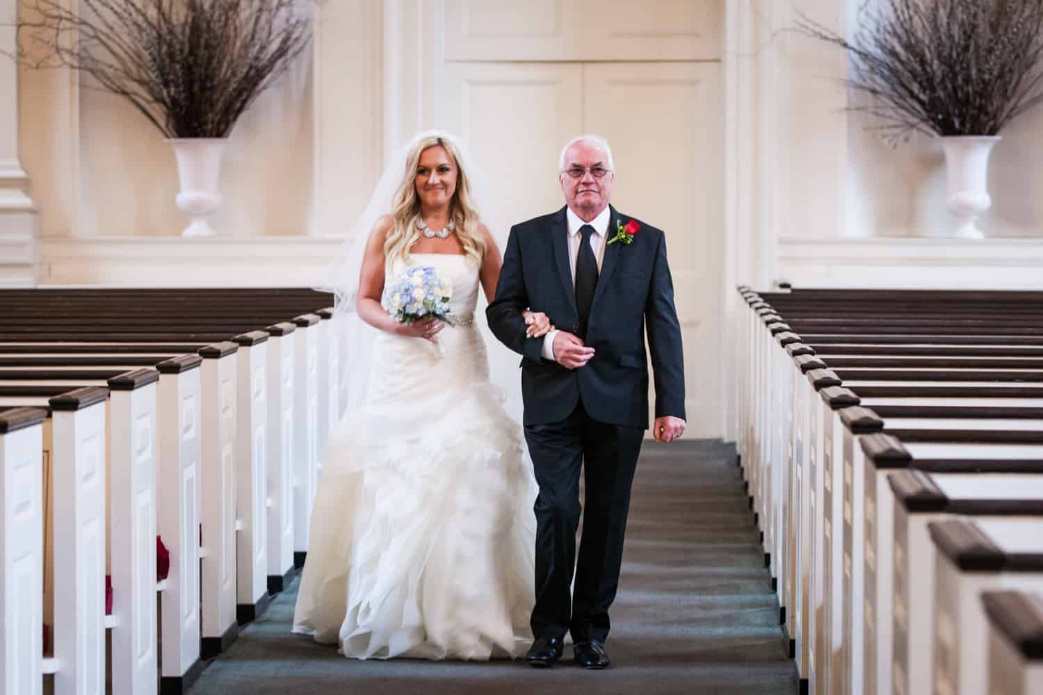 Bride and father walking down aisle during All Souls Unitarian Church ceremony