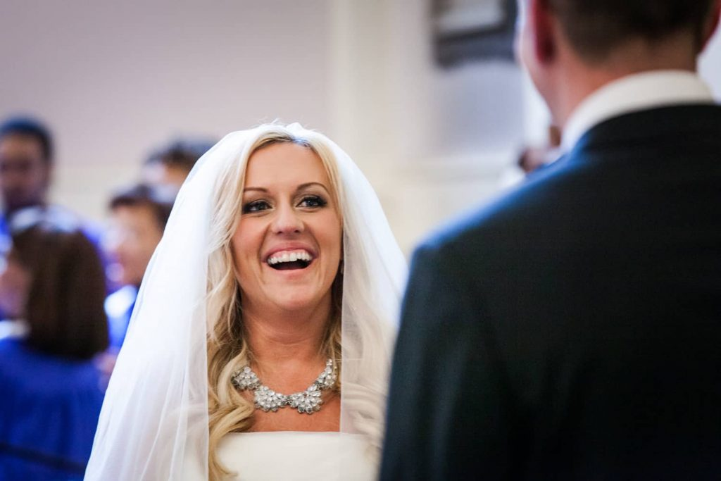 Bride laughing during All Souls Unitarian Church ceremony