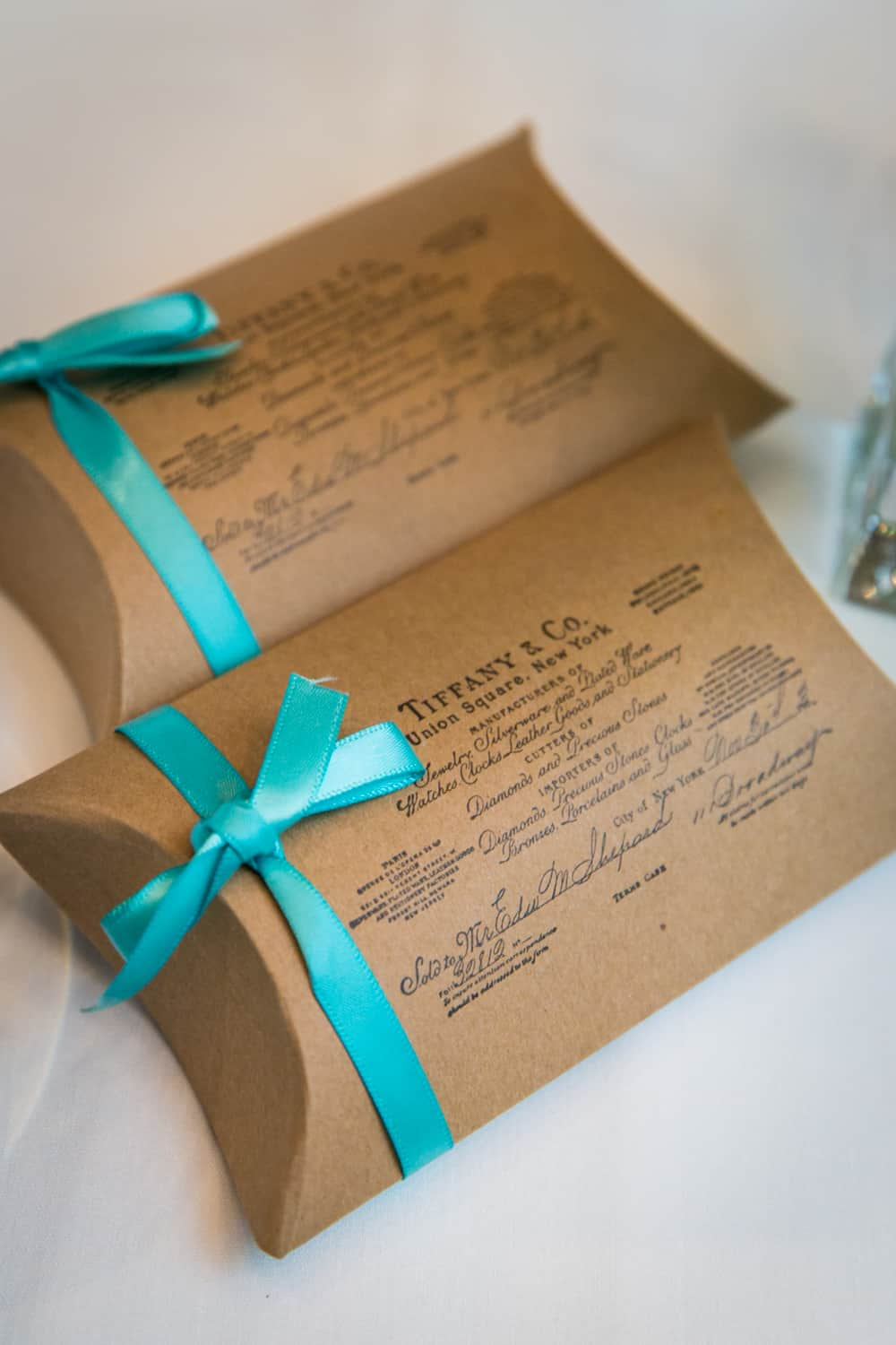 Two guest favor packets from Tiffany's at a Bergdorf Goodman wedding reception