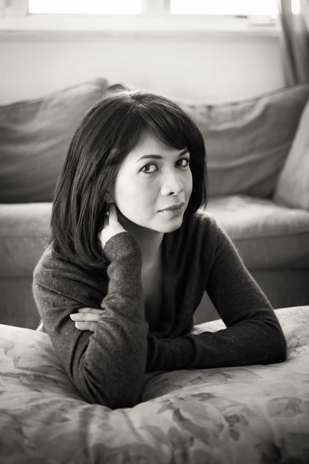 Black and white photo of woman with short black hair wearing sweater