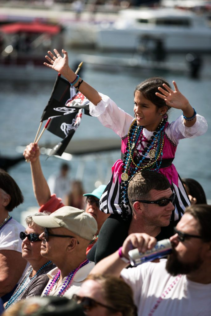 A little pirate wench begs for beads, by NYC photojouralist, Kelly Williams.