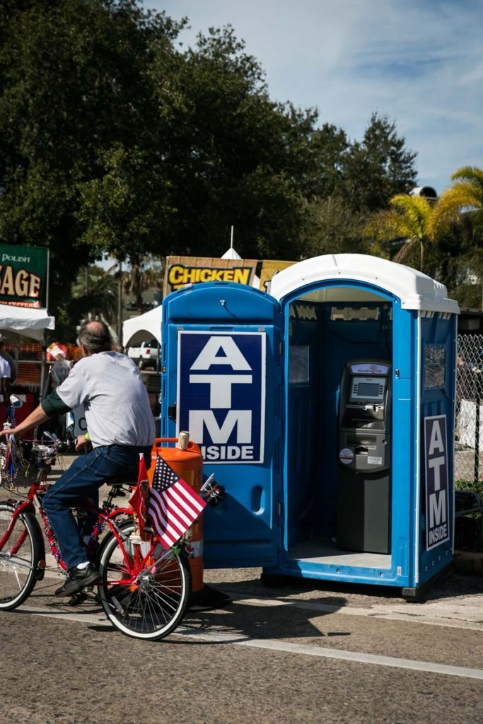 An ATM conveniently located in a port-a-potty, by NYC photojouralist, Kelly Williams.
