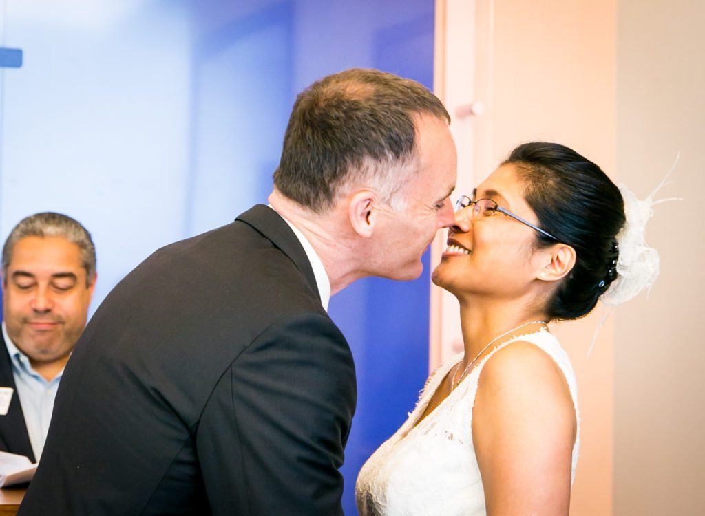 A couple kissing, by NYC City Hall wedding photographer, Kelly Williams