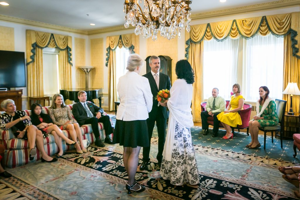 Bride and groom exchanging vows in room at a Waldorf Astoria wedding