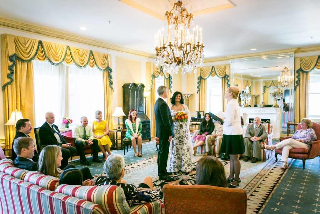 Wide shot of bride and groom exchanging vows at a Waldorf Astoria wedding