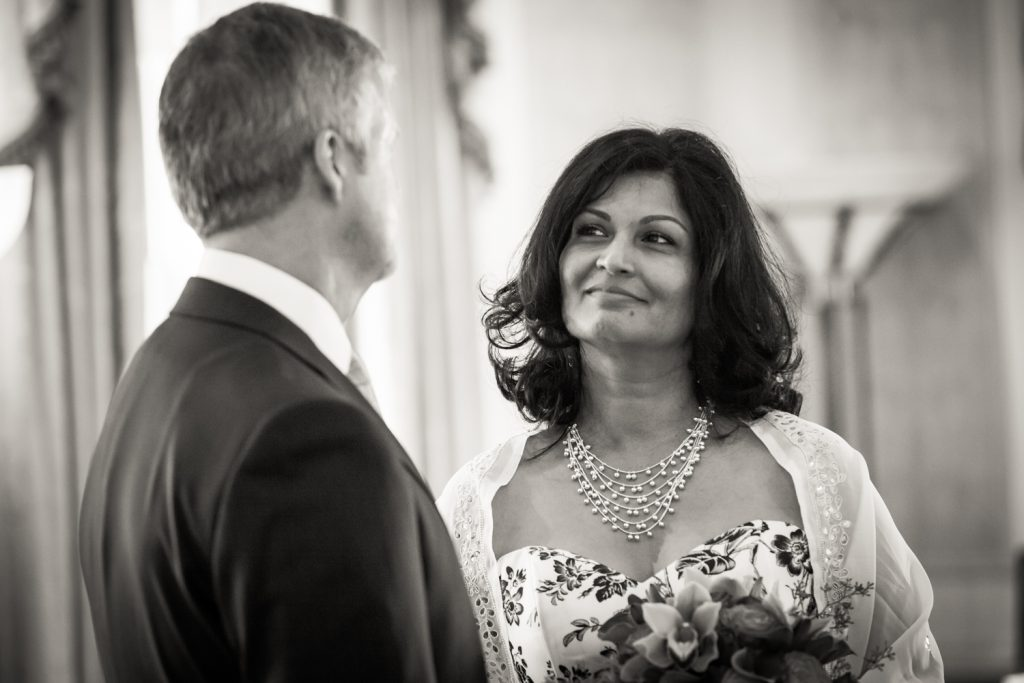 Black and white photo of bride looking at groom at a Waldorf Astoria wedding