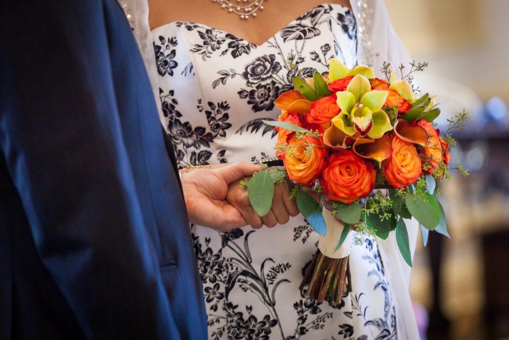 Close up on bride's orange flower bouquet at a Waldorf Astoria wedding
