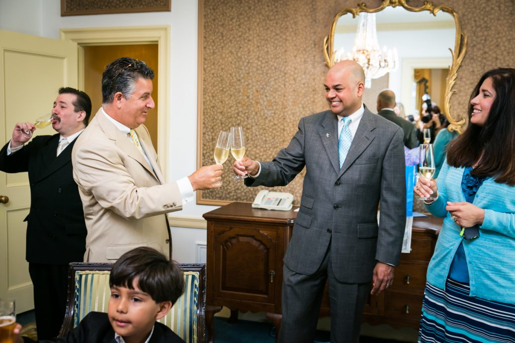 Guests toasting champagne glasses at a Waldorf Astoria wedding