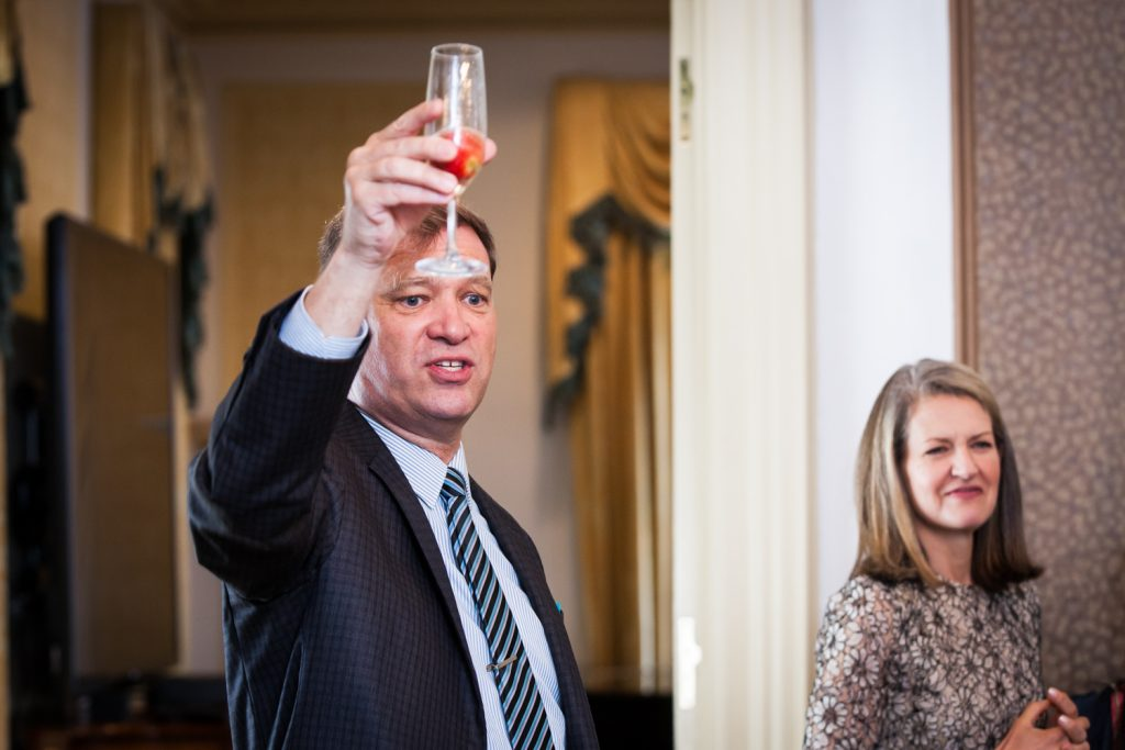 Guest raising glass of champagne at a Waldorf Astoria wedding