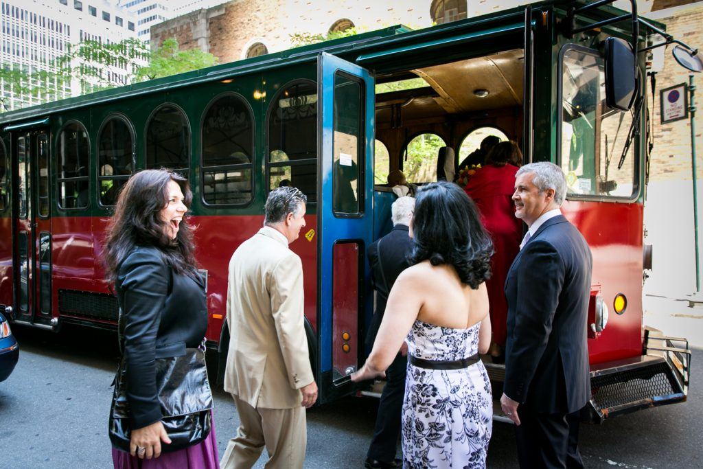 Guests getting on trolley after a Waldorf Astoria wedding