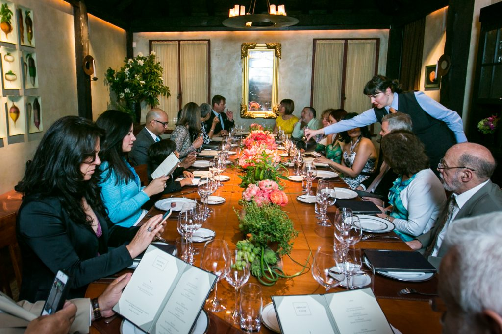 Long view of table with guests at Gramercy Tavern wedding reception