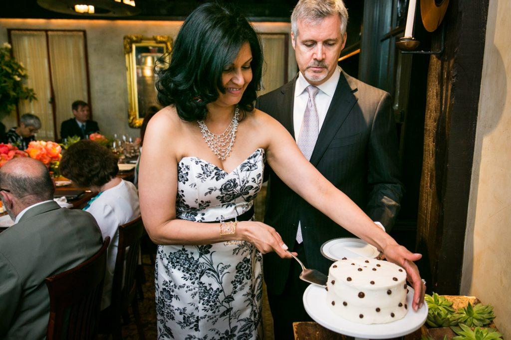 Bride and groom cutting wedding cake at Gramercy Tavern wedding reception