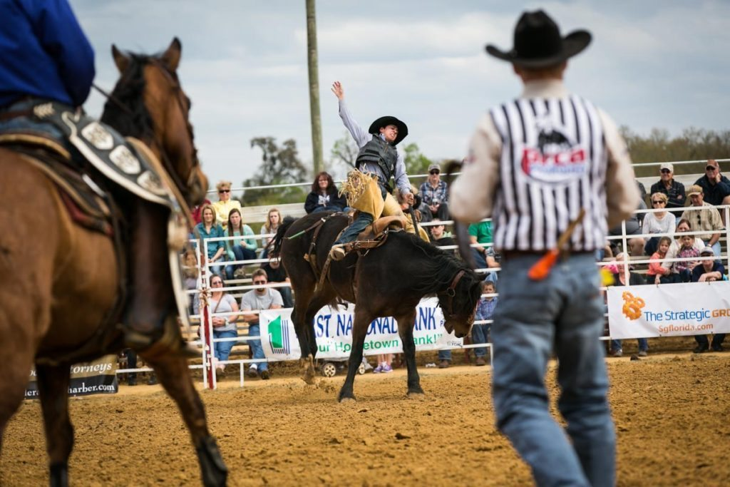 Bucking broncos at the county fair championship rodeo, by NYC photojournalist, Kelly Williams